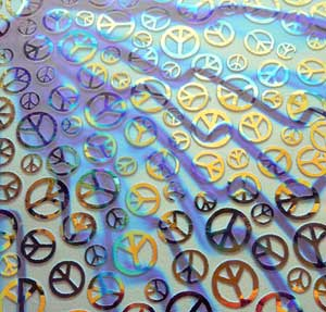 90 Sand Carved Dichroic Glass Pattern #170 Peace Sign Voltage Cyan Copper on Clear Glass. This photo taken on Purple Fabric.